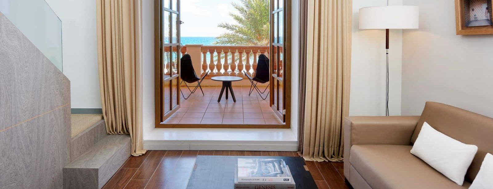 Enjoy views of the beach in our Duplex Suite at Le Méridien Ra
